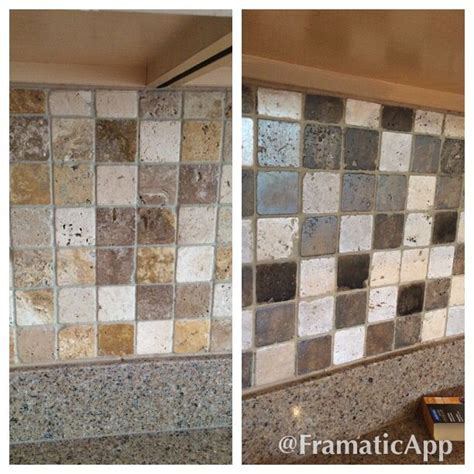 Painted travertine tile backsplash to gray tones.   DIY