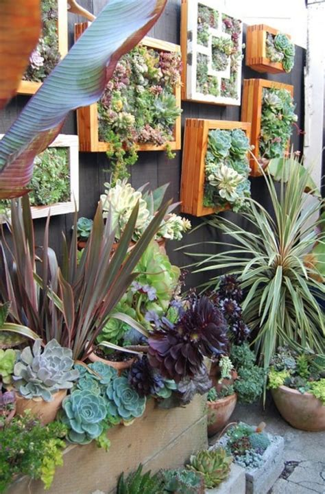 15 Tiny Outdoor Garden Ideas For The Urban Dweller Brit Co Diy Vertical Garden Wall