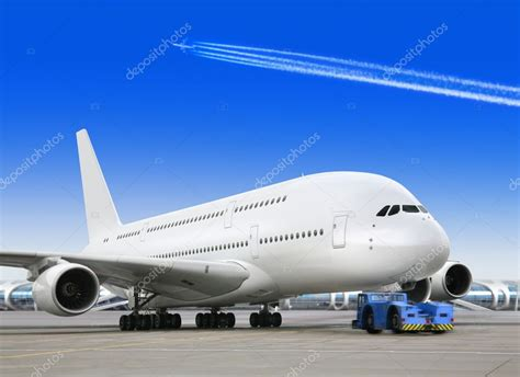 bid stock big passenger airplane in airport stock photo