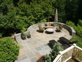 circular flagstone patio on steeply sloped backyard