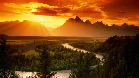 landscape nature orange sunset sun rays river pine