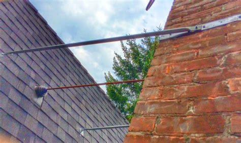 Chimney Flue Support Bracket - chimney roof brace support installation
