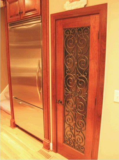 wrought iron  doors painted pantry doors
