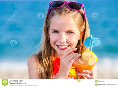 pedo beach cute girl drinking fruit cocktail on beach stock photo