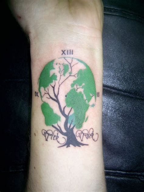 planet ink tattoo this incorporates the planet a tree and a clock to