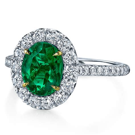 omi gems platinum engagement ring with an oval cut emerald center and halo