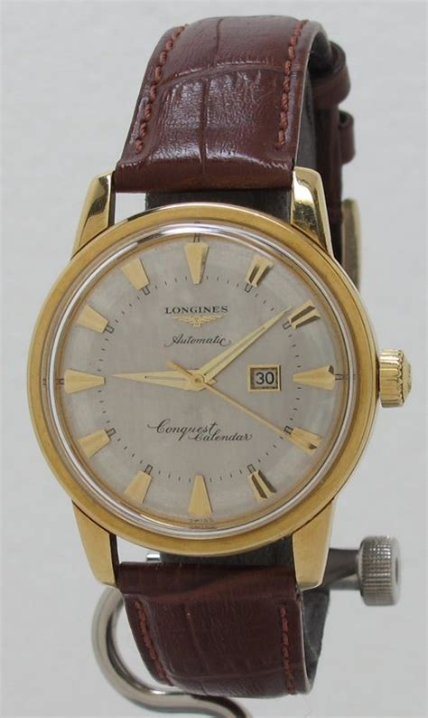Cartier Cyntia 9005 Set longines ref 9005 25 auto cal 19asd conquest calendar in 18k gold from 1957 in stunning