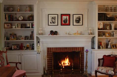 fireplace with bookshelves exposed brick wall surround fireplace wit white mantel