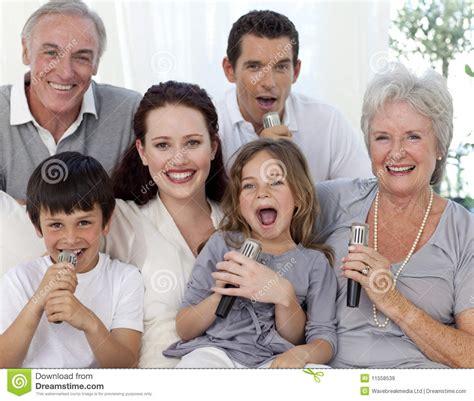 family singing karaoke at home royalty free stock images