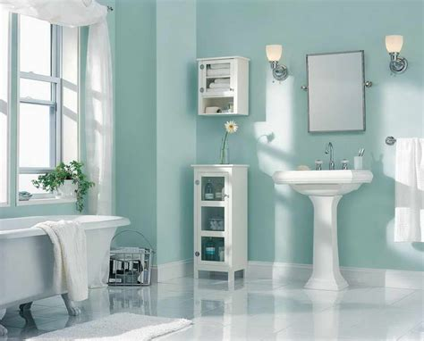 aqua coastal paint colors for bathroom with white bathtub and vanity with mirror artenzo