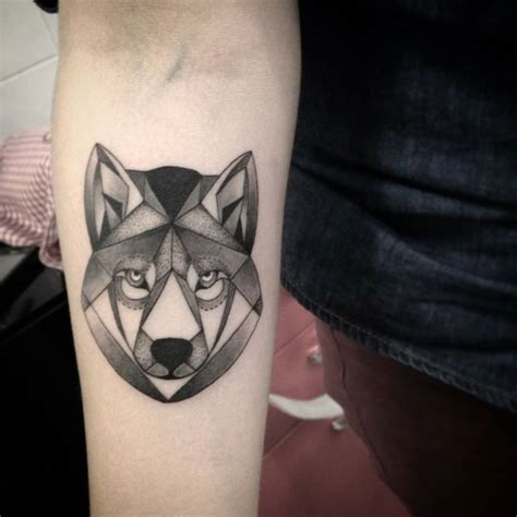 forearm tattoo of a polygon wolf by ivy saruzi