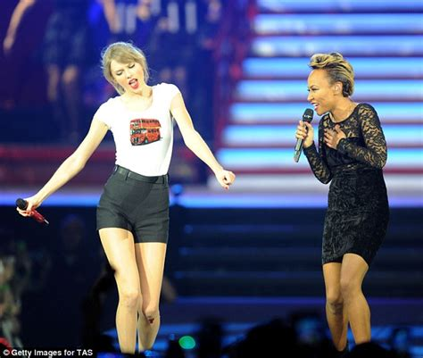 Taylor swift grabs emeli sande for a duet on stage in london saying