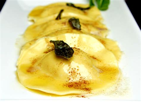hand made ravioli with portobello spinach feta and walnut filling served with a burnt butter