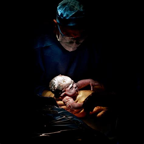 religious section photographer takes portraits of babies seconds after birth