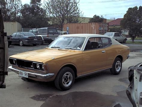 old nissan coupe datsun 180b sss coupe with that vinyl top par for the