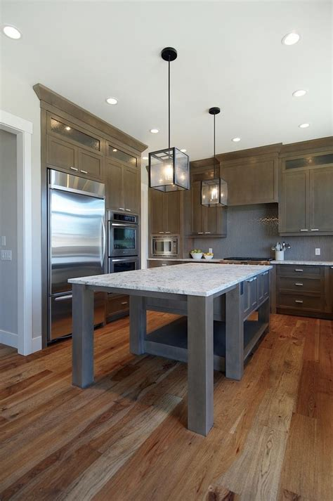 gray floors with hickory cabinets elegant artcraft lighting in kitchen contemporary with