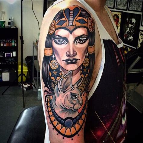 tattoo new school woman shoulder arm new school cat woman tattoo by cloak and
