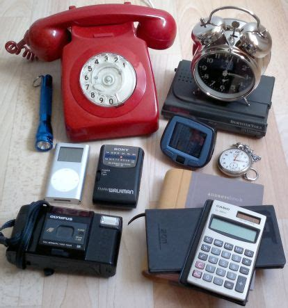 Alarm Mobil Ekarion themobile phone pictured left was used for 3 different functions as atelephone as a pocket