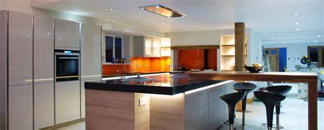 Island Kitchen Light handleless grey quartz worktops and solid oak detail uckfield