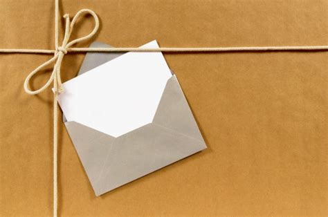 brown paper parcel with envelope and message card photo