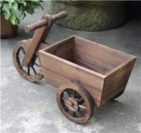 Decorative Wooden Wheelbarrow Planter by Wooden Wheelbarrow Decorative Wooden Planter Buy