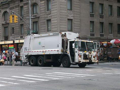 truck ny garbage truck in causes injuries and