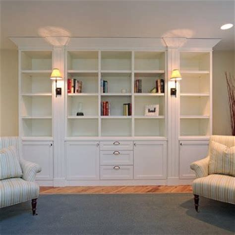 built in bookshelves convert a sparse wall space into a