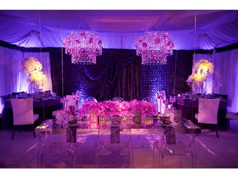 the color purple book reception glammed up wedding reception room with purple lighting and