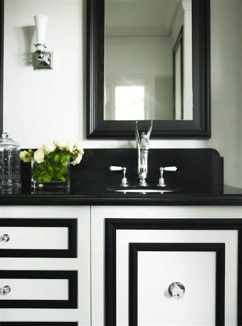 add pizazz to plain bathroom cabinets by adding molding in