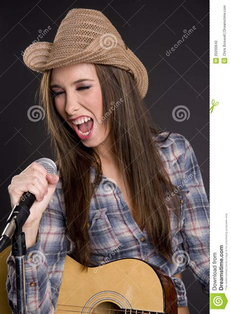 country western singer playing guitar singing song stock photo image 20200640