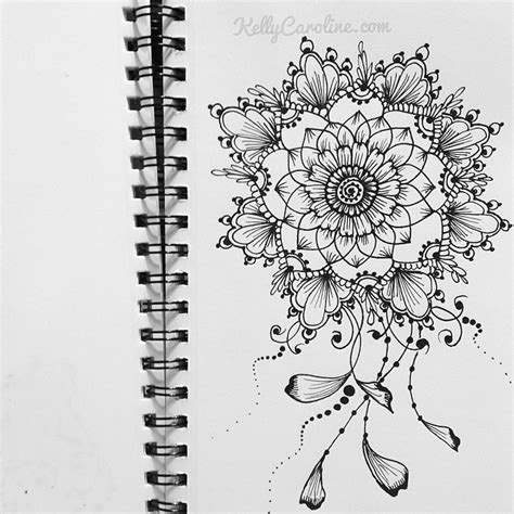 henna design in my sketchbook a mandala with vines