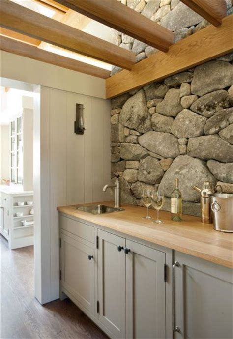 light grey kitchen cabinets with wood countertops the gray taupe cabinets with light wood countertop works