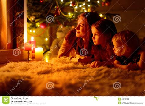happy family   fireplace  christmas stock photo