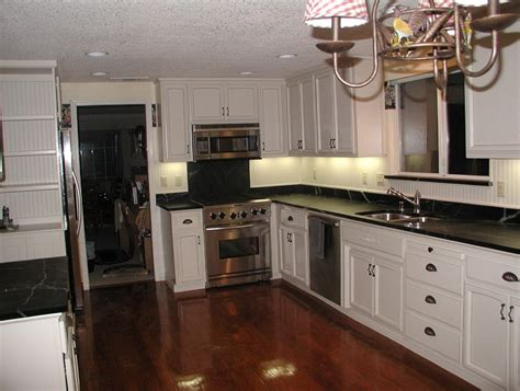 kitchens with white cabinets and black countertops backsplash with white cabinets and black countertops