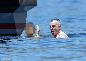 daniel day lewis takes a dip in the sea while holidaying