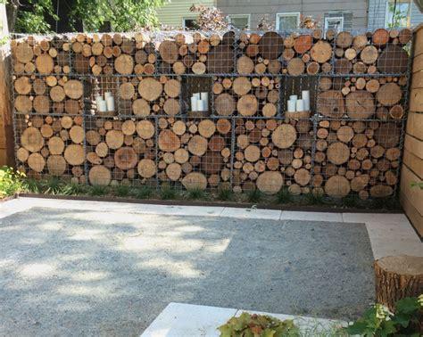 Attractive Idee Jardin Avec Gravier #10: Mur-cloture-gabion-bois-bougies-deco-exterieur.jpg