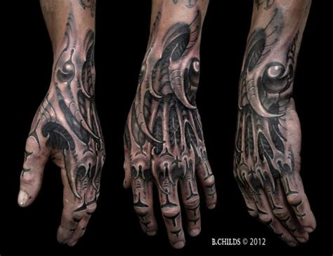 biomechanical tattoo spiderman biomechanical hand tattoo by spider monkey tattoos