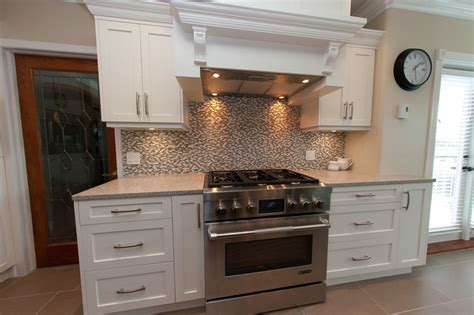 small white kitchen with steel hood cloud white maple kitchen hood fan