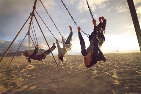 swinging with friends video beach friends girls sand sky swing image 51618 on