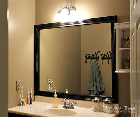 how to make a frame for a bathroom mirror framing a bathroom mirror tempting thyme