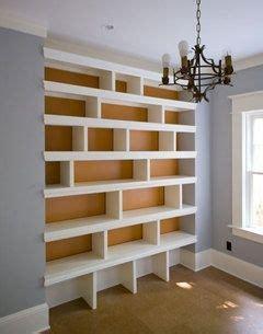 i the style of this built in bookshelf sleek modern