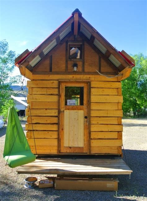 tiny cabin on wheels tiny house talk man builds log cabin tiny house with hinged overhangs