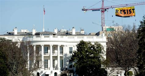 call the white house in call to arms greenpeace hangs giant resist banner above white house common