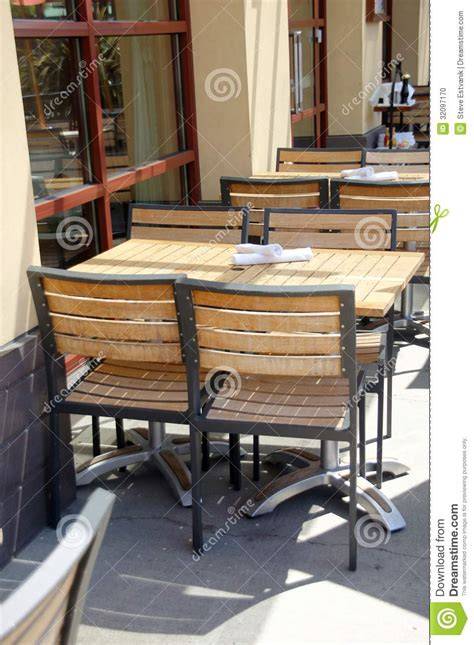 Wooden Tables And Chairs In Outdoor Restaurant Stock Photo