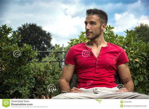 bench models men good looking fit male model sitting on bench stock photo
