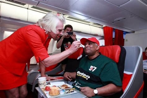 airasia owner sir richard branson dresses up as air stewardess after
