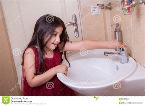 girls changing dress in bathroom little girl in the bathroom stock photo cartoondealer