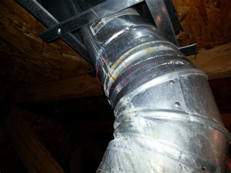 leaking condensation  heater exaust pipe  attic