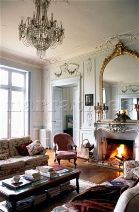 mirror above living room pe023 05 gilt framed mirror above fireplace in narratives photo agency