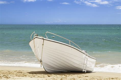 fishing boat on the beach fishing boat on the beach photograph by amanda elwell